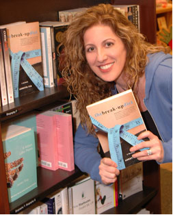 Annette holds up a copy of her book at Barnes & Noble